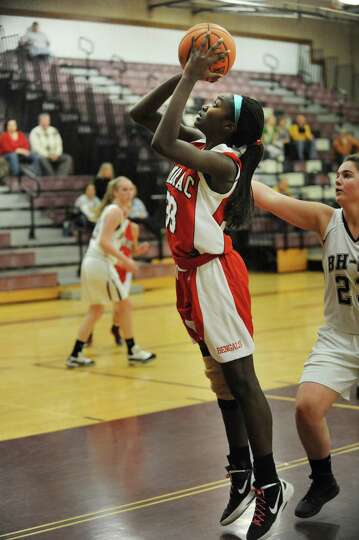Tamarac's Adiya Henderson goes up for a jump shot during a basketball game against Burnt Hills on We