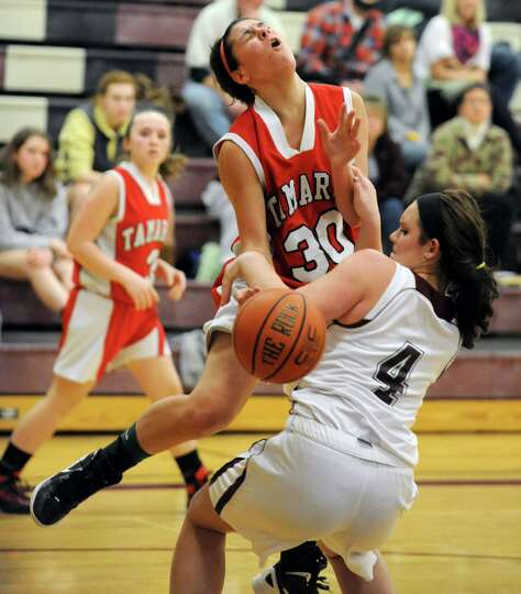 Tamarac's Briana Matazinsky is fouled by Burnt Hills' Florie Comley as she drives to the hoop during