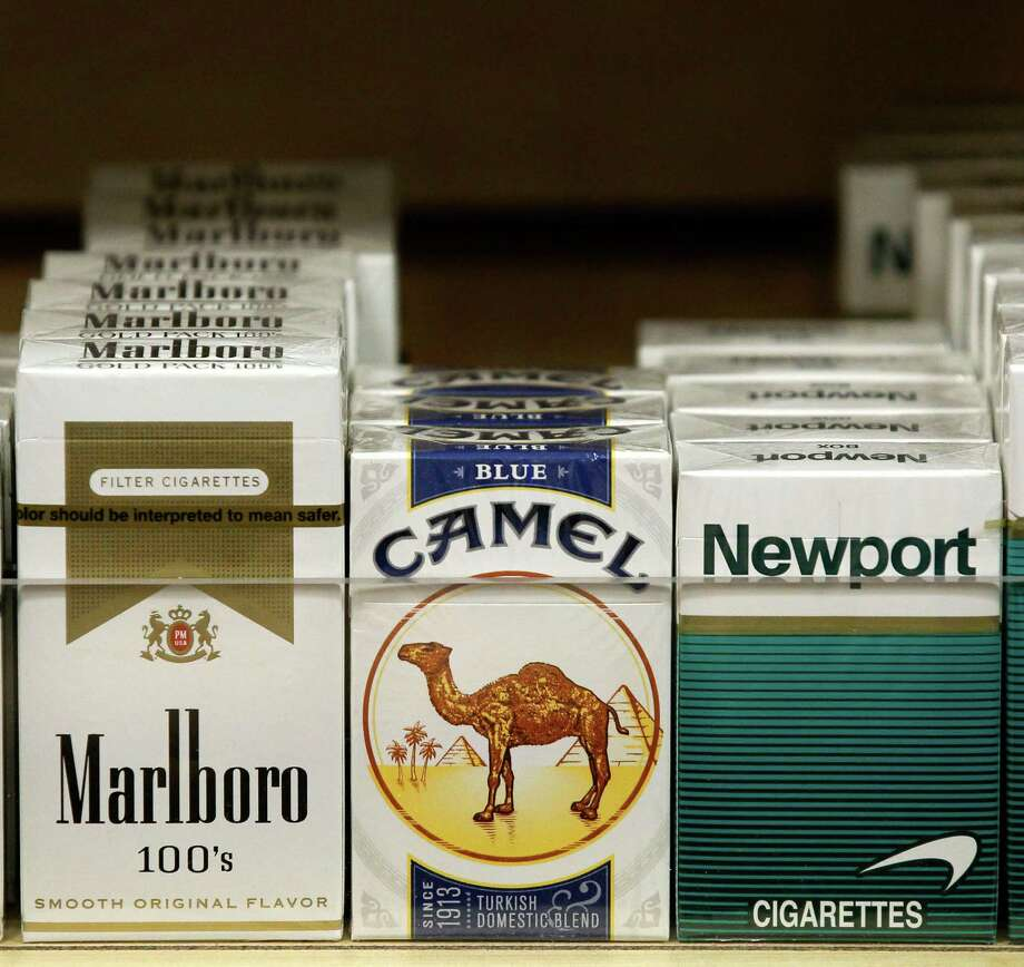 Pictured are packs of cigarettes waiting to be purchased at a Chicago area news stand Friday, Nov. 30, 2012. New tobacco products have come nearly to a halt in the U.S. because regulatory reviews for thousands of applications required by a 2009 law are taking much longer than the law requires. Though it might sound like good news from a health perspective, the halt demonstrates how tricky it is to start regulating an industry.(AP Photo/Charles Rex Arbogast) Photo: Charles Rex Arbogast / AP