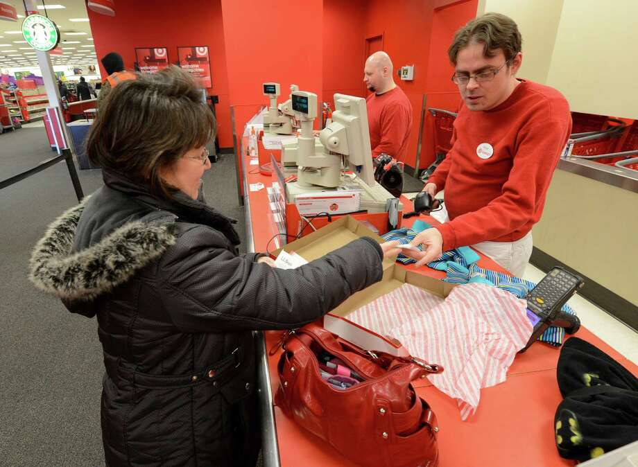 Eileen Dooley returns a Christmas gift with the help of customer service agent Victor Sheckels at the Target store in Northway Mall in Colonie, N.Y.  Dec 26, 2012. (Skip Dickstein/Times Union) Photo: SKIP DICKSTEIN / 00020573A
