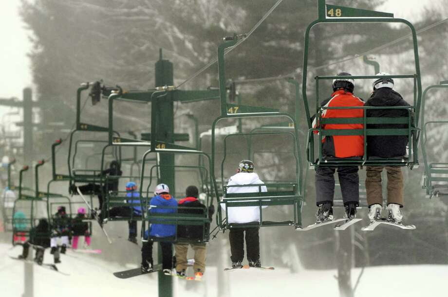 Skier and snowboarders ride the chair lift on Wednesday, Dec. 26, 2012, at Maple Ski Ridge in Rotterdam, N.Y. (Cindy Schultz / Times Union) Photo: Cindy Schultz / 00020584A