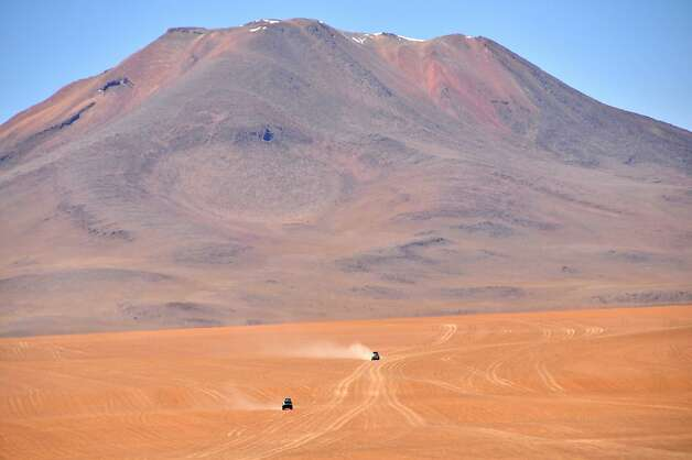 Crossing the Bolivian Altiplano toward the Chile border, boulder-strewn ruts serve as roads; dusty routes traverse wide-open plains. Photo: Margo Pfeiff, Special To The Chronicle