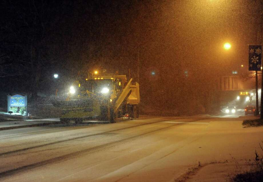 A snow plow makes its way up Delaware Avenue in Delmar, N.Y., Wednesday Dec. 26 2012. (Michael P. Farrell/Times Union) Photo: Michael P. Farrell