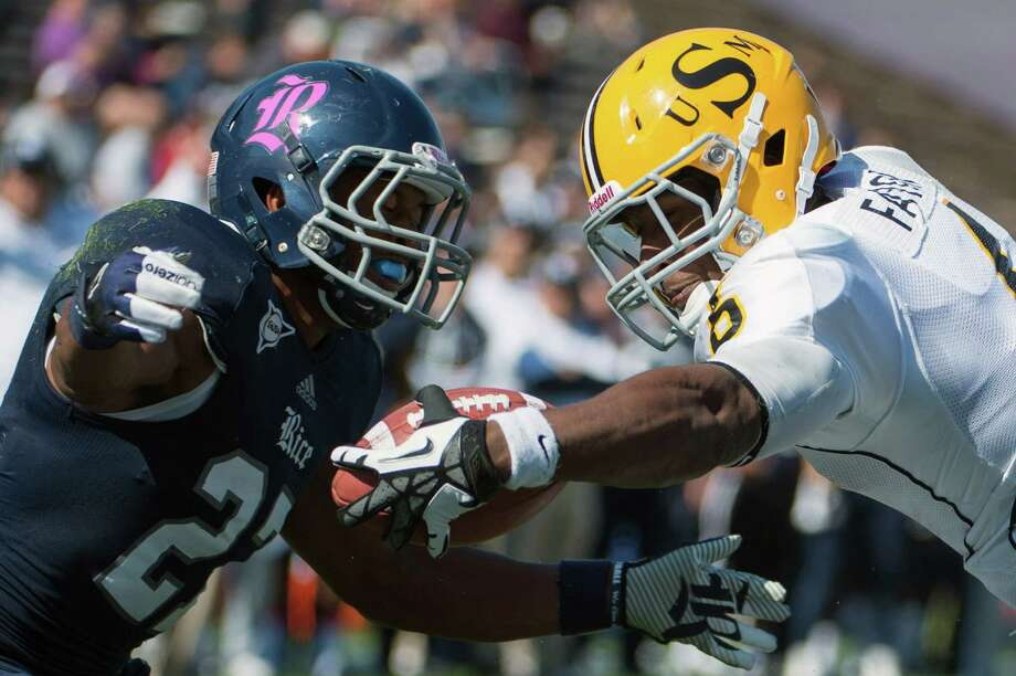 Southern Miss quarterback Arsenio Favor (6) stretches the ball over the goal line past Rice safety Gabe Baker (27) on a 16-yard touchdown run during the third quarter of an NCAA college football game at Rice Stadium, Saturday, Oct. 27, 2012, in Houston. Rice won the game 44-17.( Smiley N. Pool / Houston Chronicle ) Photo: Smiley N. Pool, Staff / © 2012  Houston Chronicle