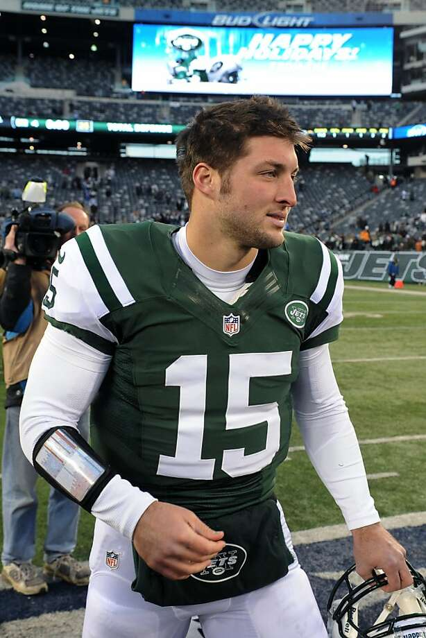 New York Jets quarterback Tim Tebow (15) walks on the field after an NFL football game against the San Diego Chargers, Sunday, Dec. 23, 2012 in East Rutherford, N.J. The Chargers won 27-17. (AP Photo/Bill Kostroun) Photo: Bill Kostroun, Associated Press