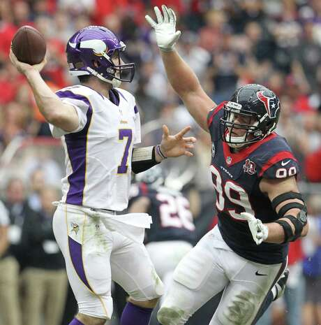 Houston Texans defensive end J.J. Watt (99) applies pressure to Minnesota Vikings quarterback Christian Ponder (7) during the first quarter of an NFL football game at Reliant Stadium, Sunday, Dec. 23, 2012, in Houston.  ( Karen Warren / Houston Chronicle ) Photo: Karen Warren, Staff / © 2012 Houston Chronicle
