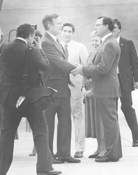Vice President George H.W. Bush is greeted by Congressman Tom Loeffler upon his arrival in San Antonio on May 6, 1987, for a private fundraising dinner. Judge Roy Barrera is standing behind them. Photo: San Antonio Light File Photo