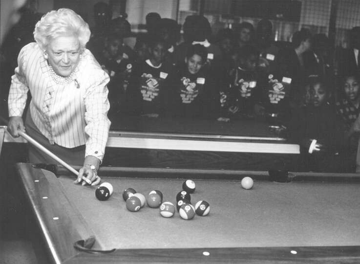 First Lady Barbara Bush plays a quick game of pool Feb. 26, 1992, during her visit to the Boys & Gir