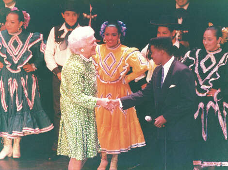 First Lady Barbara Bush shakes hands with San Antonio singer Sandy Wyatt after a show at the Majestic Theater on July 10, 1990. Bush was in town as part of the Economic Summit. Photo: San Antonio Light File Photo
