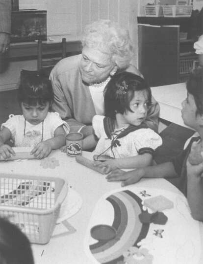 First Lady Barbara Bush watches children work while touring the Avance Child Development Center on S