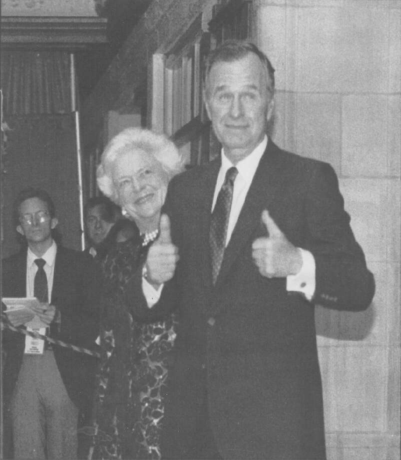 "President George H.W. Bush gives a ""thumbs up"" to the crowd at the Majestic Theater as First Lady Barbara Bush looks on Feb. 27, 1992.  President and Mrs. Bush are in San Antonio for the seven-nation drug summit that President Bush is hosting. Photo: San Antonio Light File Photo"