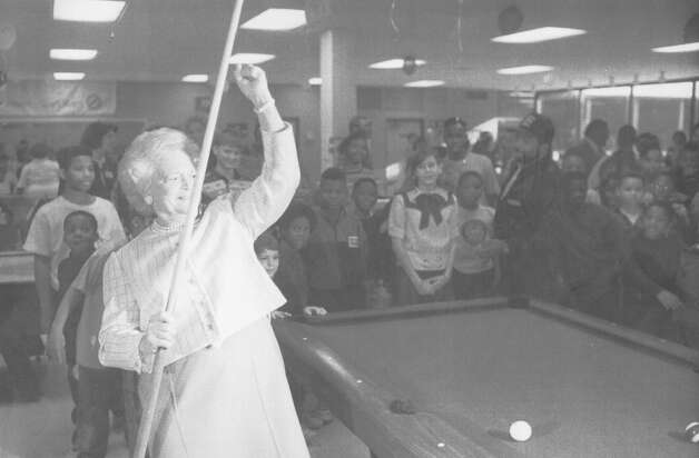 First Lady Barbara Bush reacts after making a shot while playing pool during a tour of a Boys & Girls Clubs of San Antonio on Feb. 26, 1992. She is in San Antonio with President George H.W. Bush for the seven-nation drug summit that President Bush is hosting. Photo: San Antonio Light File Photo