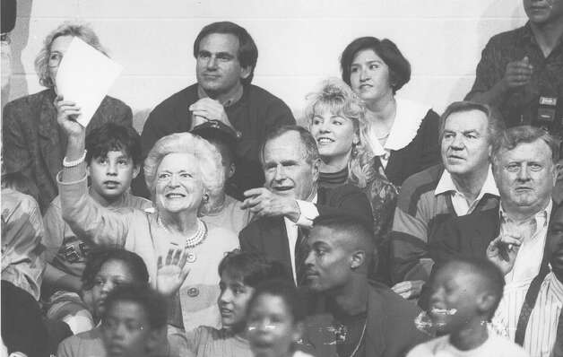 "President George H.W. Bush and his wife, Barbara, cheer at the action Feb. 26, 1992, during a Spurs-sponsored ""Drug-Free Basketball League"" game at the West End Multi-Service Center Gym. Photo: San Antonio Light File Photo"