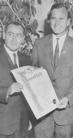 A smiling George H.W. Bush, wearing a button on a visit to San Antonio in his Republican race for U.S. Senate, receives a HemisFair ambassador certificate from William Sinkin, president of the fair, on Oct. 15, 1964. Photo: San Antonio Express-News File Photo