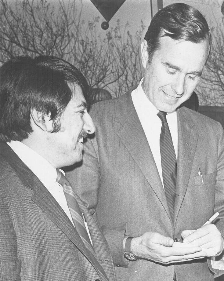 U.S. Rep. George H.W. Bush signs an autograph for Carlos Alvarado, a St. Mary's Young Republican, on Jan. 14, 1970 during a visit to San Antonio. Photo: San Antonio Express-News File Photo