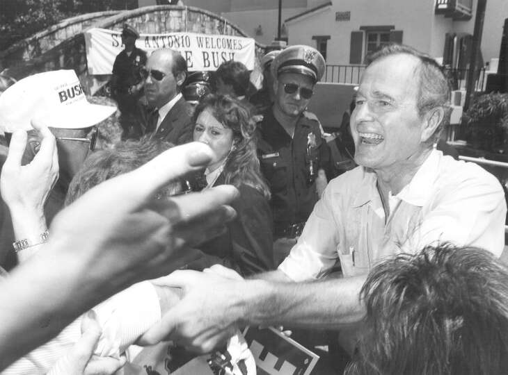Vice President and presidential candidate George H.W. Bush shakes hands with the crowd following a r