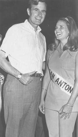 "Miss San Antonio Betsy Hart takes the stump with U.S. Rep. George H.W. Bush, Republican nominee for the U.S. Senate on Aug. 26, 1970. Bush addressed a crowd estimated by Constable Bill Hancock at 1,200 at MacArthur Park at a ""Hamburgers with Bush"" supper, and autographed pictures for supporters after making his campaign pitch. Photo: San Antonio Express-News File Photo"