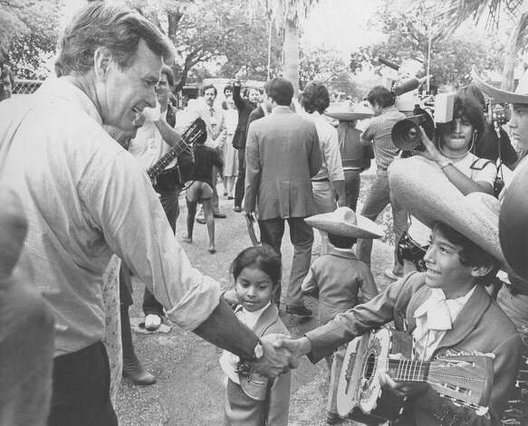 Vice presidential hopeful George H.W. Bush shakes hands with a young Mariachi with Mariachi Infantil Guadalupano while stumping in Mission County Park on Sept. 7, 1980. Photo: San Antonio Express-News File Photo