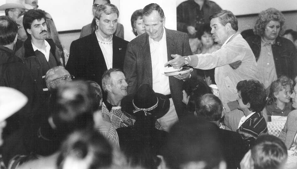 President George H.W. Bush meets Beeville residents at a barbecue held in his honor on Dec. 28, 1991