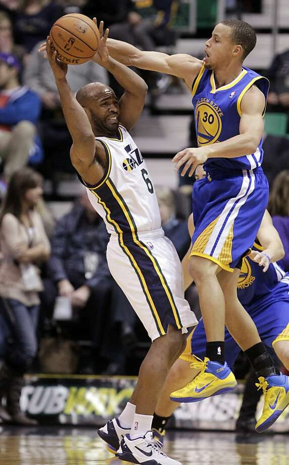 Golden State Warriors point guard Stephen Curry (30) defends against Utah Jazz point guard Jamaal Tinsley (6) in the first quarter of an NBA basketball game, Wednesday, Dec. 26, 2012, in Salt Lake City. (AP Photo/Rick Bowmer) Photo: Rick Bowmer, Associated Press