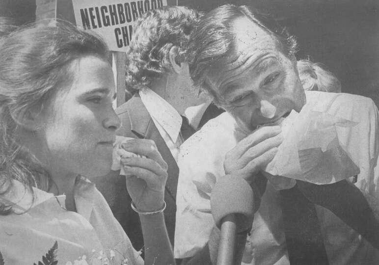 Presidential hopeful George H.W. Bush enjoys a taco with daughter Dorothy Bush at El Mercado on a vi