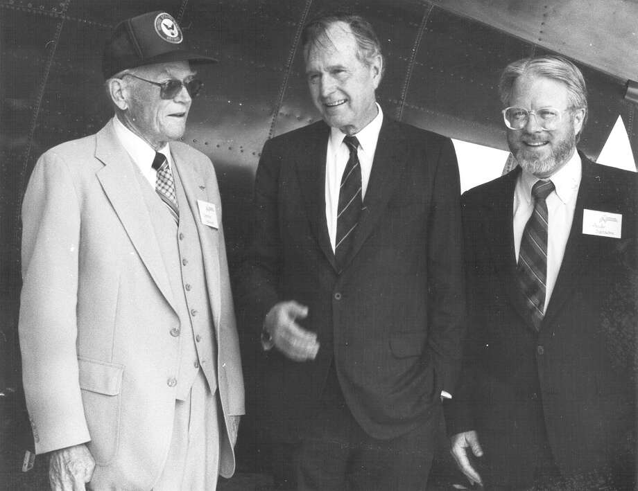 Texas Parks and Wildlife Executive Director Andy Sansom (right) and his father, Sammy Sansom (left), talk with former President George H.W. Bush on March 3, 1993, at the Admiral Nimitz Museum in Fredericksburg. Photo: San Antonio Express-News File Photo
