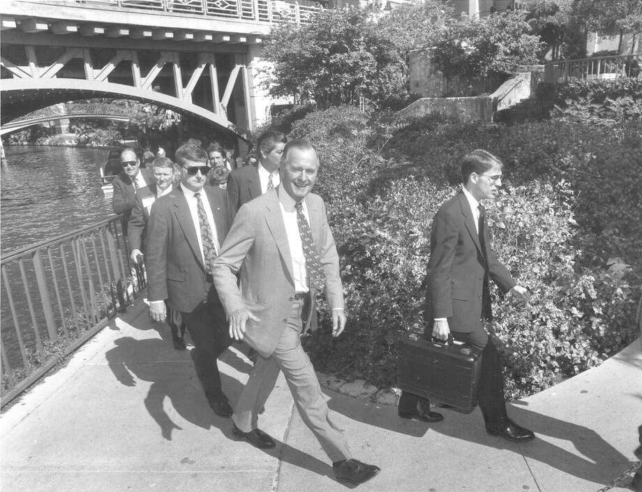 Former President George H.W. Bush decides on a last-minute walk after a luncheon speech at the NSDJ convention at the Marriott Rivercenter on Oct. 25, 1993. Photo: San Antonio Express-News File Photo