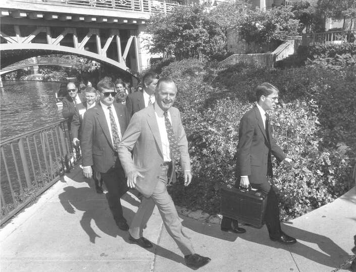 Former President George H.W. Bush decides on a last-minute walk after a luncheon speech at the NSDJ