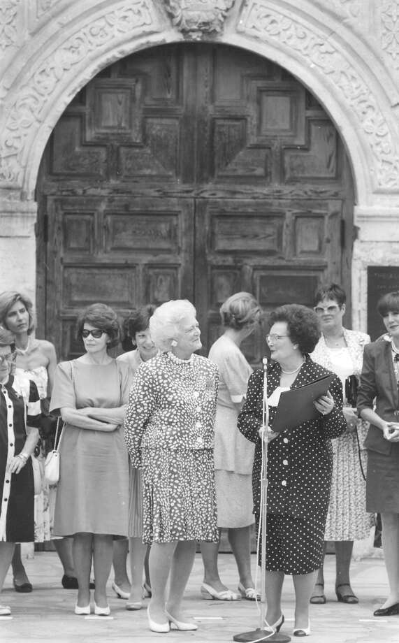 San Antonio Mayor Lila Cockrell makes a proclamation to First Lady Barbara Bush in front of the Alamo on July 10, 1990, as part of the Economic Summit visit. Photo: San Antonio Express-News File Photo