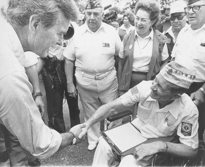 Vice presidential hopeful George H.W. Bush shakes hands with Red Allen while stumping in Mission Cou