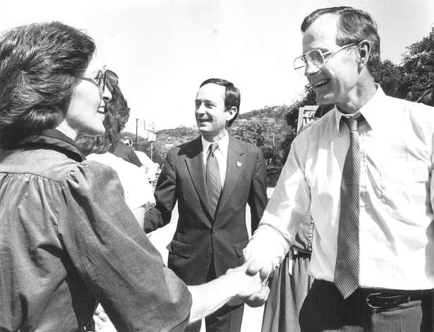 Vice President George H.W. Bush shakes hands with an unidentified woman while visiting San Antonio in October 1982. Jeff Wentworth is at center. Photo: San Antonio Express-News File Photo