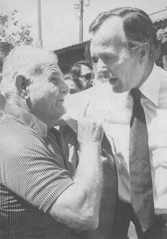 William Be visits with presidential hopeful George H.W. Bush at El Mercado on May 2, 1980. Photo: San Antonio Express-News File Photo