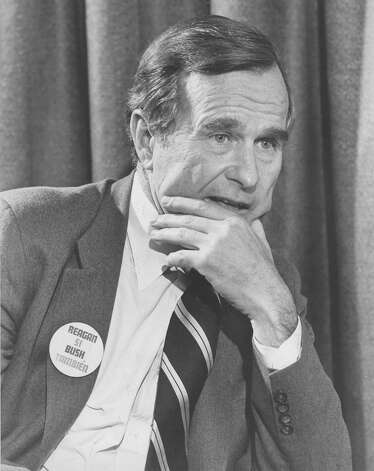 "Vice presidential hopeful George H.W. Bush is seen during an interview at the San Antonio International Airport in 1980. His button says, ""Reagan si, Bush también."" (""Yes to Reagan and also to Bush."") Photo: San Antonio Express-News File Photo"