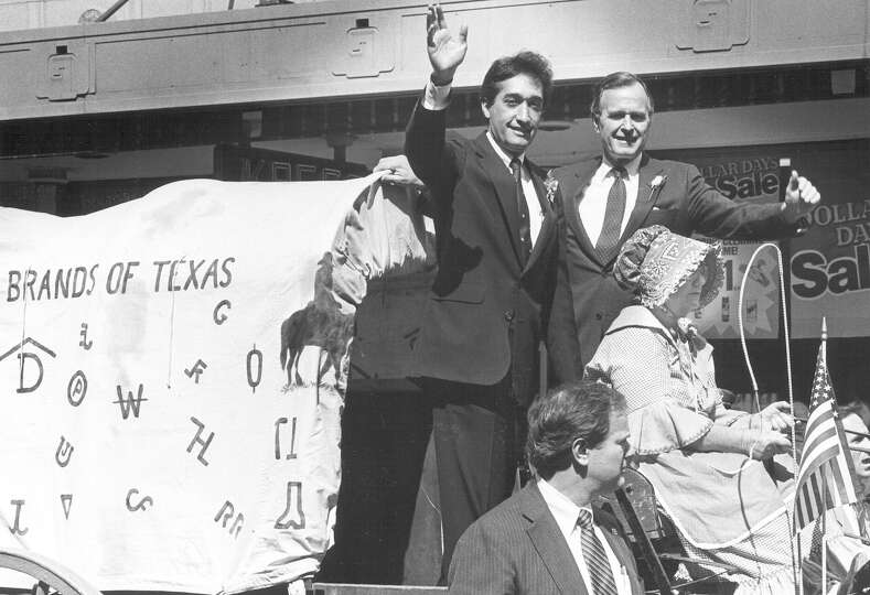 San Antonio Mayor Henry Cisneros and Vice President George H.W. Bush ride a float along the parade r
