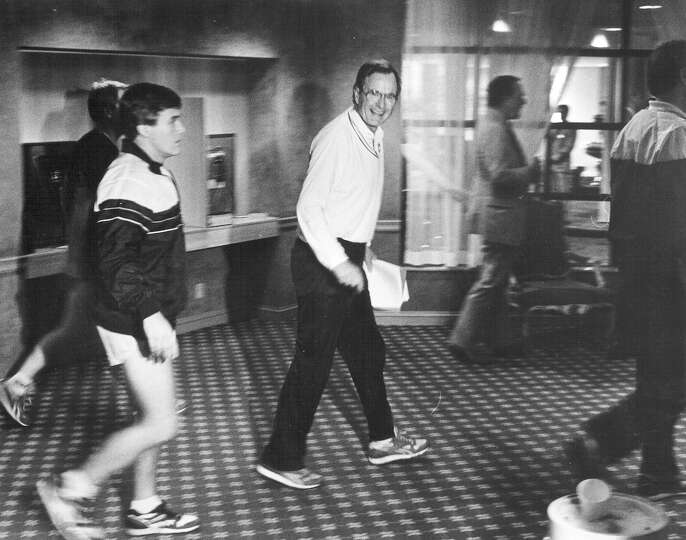 Vice President George H.W. Bush returns to the St. Anthony's Hotel after a morning jog on March 24,