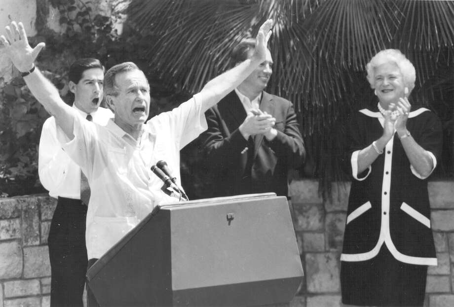 Vice President and presidential candidate George H.W. Bush acknowledges the crowd as Roy Barrera Jr., Tom Loeffler and wife Barbara Bush applaud during a rally at Arneson River Theater on Aug. 25, 1988. Photo: San Antonio Express-News File Photo