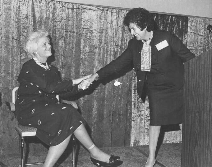 Second Lady Barbara Bush shakes hands with Lupe Anguiano, director of women's education employment a