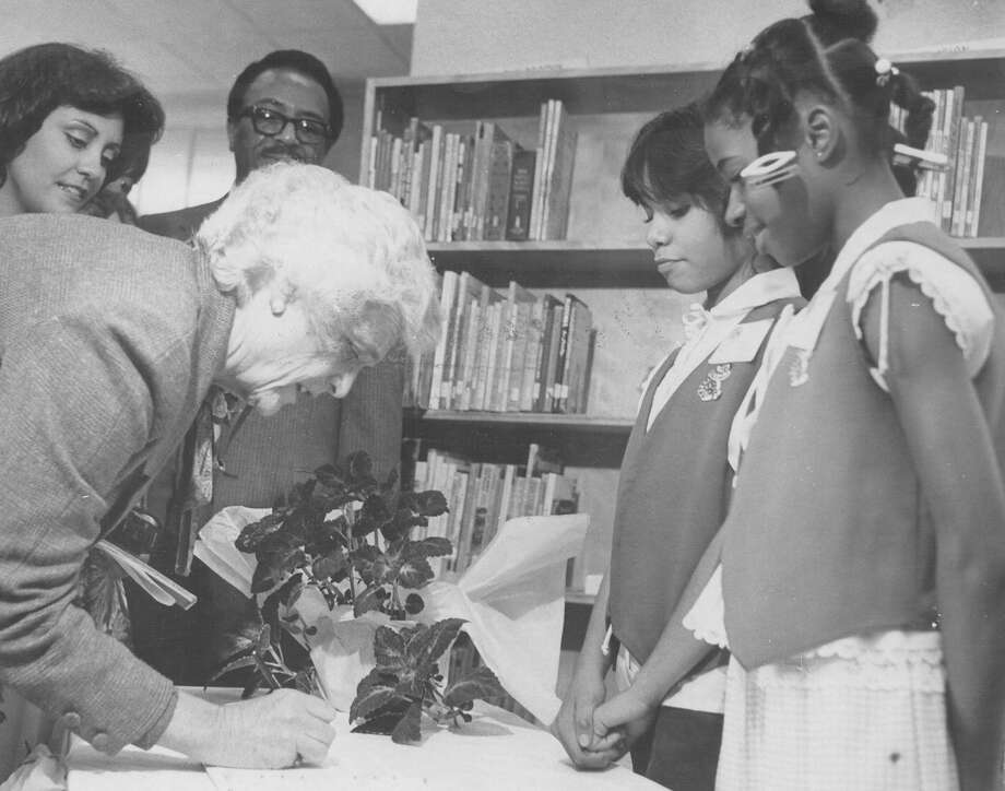 Second Lady Barbara Bush signs the registry at Smith Elementary School as Student Council President Sheila Torres (center left) and Vice President Monique Carr look on in 1981. Photo: San Antonio Express-News File Photo