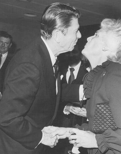 President-elect Ronald Reagan leans into to kiss soon-to-be Second Lady Barbara Bush in December 198