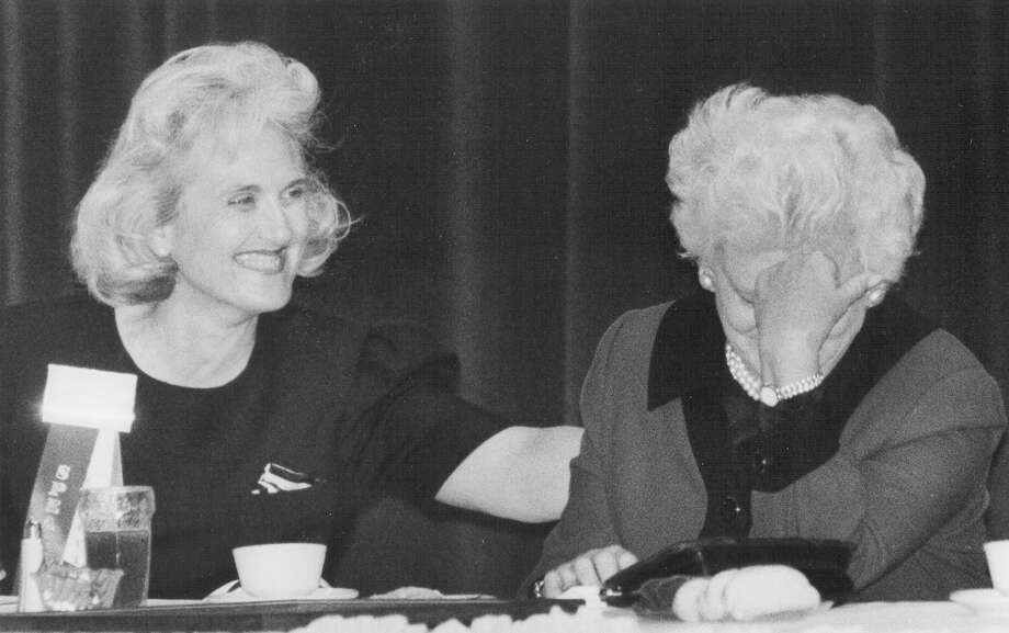 "Carter Castille, conference chairwoman for the 24th Texas Legislative Conference, looks on with laughter as First Lady Barbara Bush hides her face, showing her bashful side. Tom Loeffler was singing Bush's praises, as she was honored as the ""Texan of the Year"" on March 23, 1990. Photo: San Antonio Express-News File Photo"