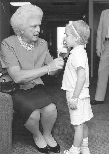 First Lady Barbara Bush talks to Courtney Dye of San Antonio, the national poster child for the Leuk