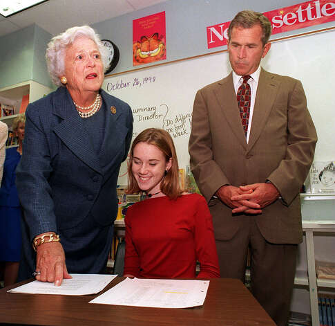 Former First Lady Barbara Bush and her son, Texas Gov. George W. Bush, go over a reading assignment complete by eighth-grader Ashley Thompson, 13, during the dedication of Northside Independent School District's Barbara Bush Middle School on Oct. 26, 1998. Photo: JOHN DAVENPORT, San Antonio Express-News File Photo / TXSAE