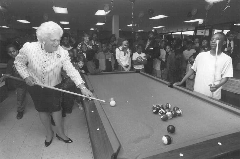 First Lady Barbara Bush plays pool with 12-year-old Tyrone Darden at the East Branch of the Boys & G