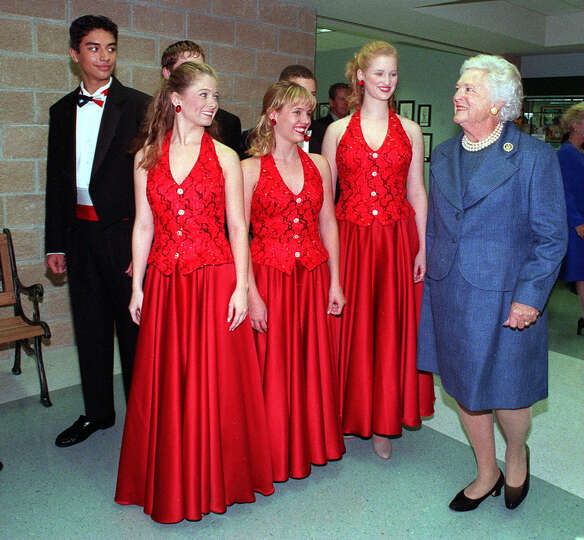 Former First Lady Barbara Bush is greeted by the BRAVO! performance troupe during the dedication of