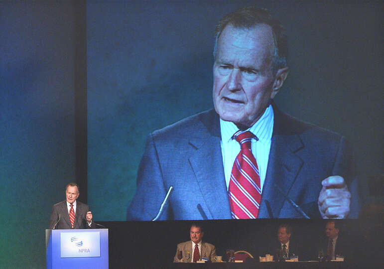 Former President George H.W. Bush speaks to the National Petroleum Refiners Convention during a lunc