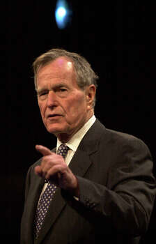 "Former President George H.W. Bush speaks to an audience at the Coldwell Bankers Convention at the Henry B. Gonzalez Convention Center on March 2, 2002. Bush touched on topics ranging from his ""thousand points of lights"" to his son's presidency during his presentation. Photo: KIN MAN HUI, San Antonio Express-News File Photo"
