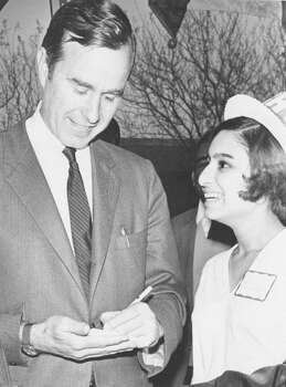 U.S. Rep. George H.W. Bush signs an autograph for Frances Jimenez, a St. Mary's Young Republican, on Jan. 14, 1970. Photo: San Antonio Express-News File Photo
