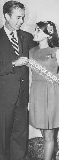 U.S. Senate hopeful George H.W. Bush poses with a supporter in this undated file photo.
