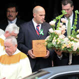 The ashes of Mary Joy Sherlach are carried from St. Stephen Church, in Trumbull, Conn., following a funeral mass Dec. 21st, 2012. Sherlach was a school pychologist at Sandy Hook Elementary School, in Newtown, and died in the mass shooting there last Friday.