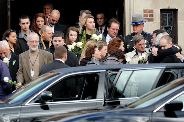 Mourner leave St. Stephen Church, in Trumbull, Conn., following a funeral mass for Mary Joy Sherlach Dec. 21st, 2012. Sherlach was a school pychologist at Sandy Hook Elementary School, in Newtown, and died in the mass shooting there last Friday. Photo: Ned Gerard / Connecticut Post